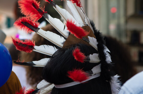 Close-up Of Person Wearing Headdress