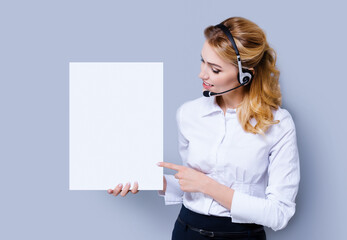 Call Center Service concept - customer support or sales agent. Businesswoman or caller or receptionist phone operator pointing at sign board with copy space. Helping, answering, consulting.