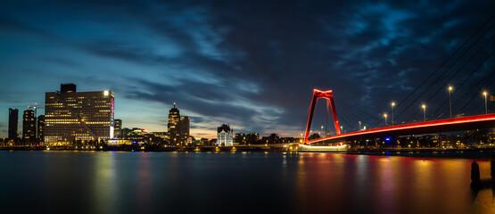 Foto auf Acrylglas Rotterdam Bridge Over River With Illuminated Buildings In Background At Night