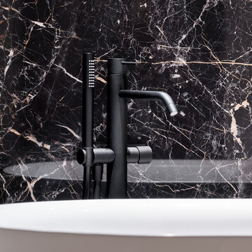 Close-up on black bathtub faucet