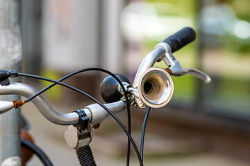 Close-up of a Vintage bicycle horn on handlebar, selective focus