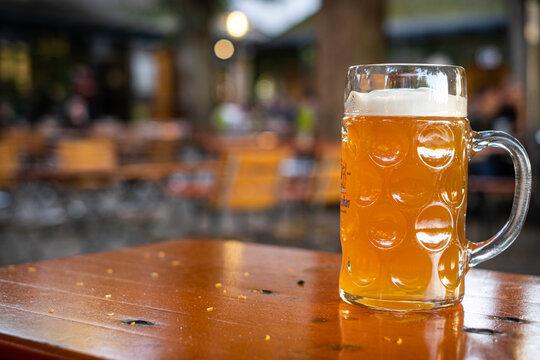big glass of yeast beer in a beer garden