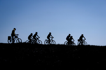 Activities of the group of happy, healthy and energetic cyclists