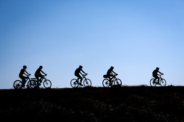 outdoor sports, group of friends cycling outdoors