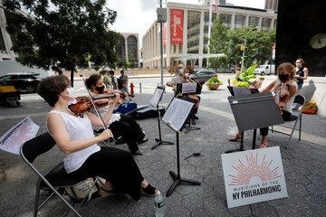 A string quartet made up of musicians from the New York Philharmonic Orchestra play first public performance since March in New York