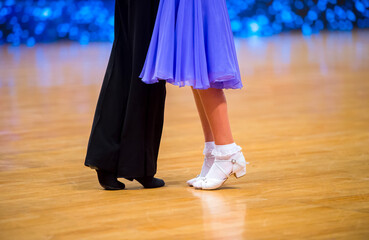 Attractive young couple of children dancing ballroom dance. Girl and boy dancer latino...