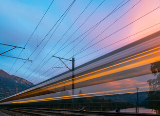 Low Angle View Of Train Against Sky During Sunset
