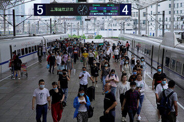People wearing face masks are seen at Shanghai Railway Station