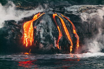 Active lava flow volcanic eruption magma touching the ocean in Big Island, Kilauea volcano, Hawaii.