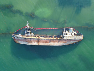 The sunken ship, the ship ran aground. Aerial view from the drone