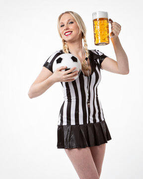 Happy sexy woman in soccer referee look with a beer and football in her hands #C6945