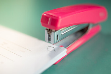 Close-up Of Stapler And Papers On Table