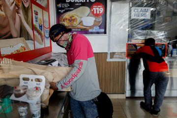 Food deliveries amid the coronavirus disease (COVID-19) outbreak in Manila