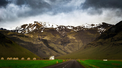 A valley with impressive Icelandic mountains in the background