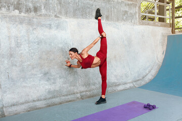Fitness Girl Stretching Near Concrete Wall. Fit Woman With Sexy Muscular Body In Fashion Sporty...