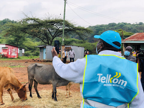 Telkom Kenya CEO Mugo Kibati uses his cell phone to test the Loon technology internet via video call as Alphabet Inc begins offering the world's first commercial high-speed internet using balloons to villagers in Radad