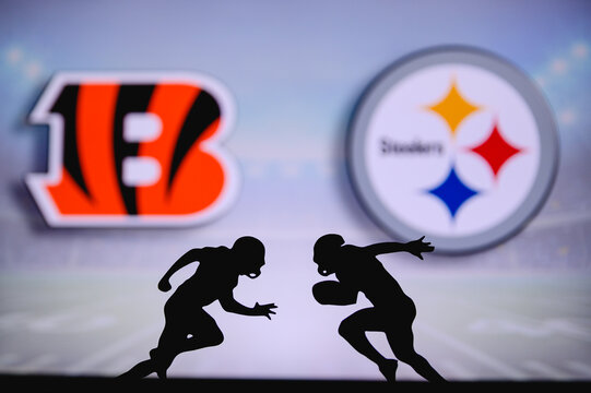 Cincinnati Bengals vs. Pittsburgh Steelers. NFL match poster. Two american football players silhouette facing each other on the field. Clubs logo in background. Rivalry concept photo.