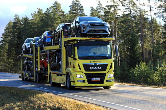 Yellow MAN TGS 18.420 Car Carrier Hauls New Cars