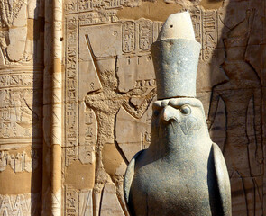 Temple statue of the ancient Egyptian god Horus at Edfu in Egypt.