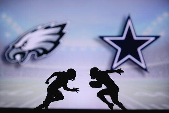 Philadelphia Eagles vs. Dallas Cowboys. NFL match poster. Two american football players silhouette facing each other on the field. Clubs logo in background. Rivalry concept photo.