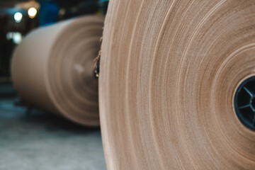 Big Stack of Printing Paper Rolls in Warehouse. The concept of production of paper and paperboard....