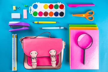 Back to school, education background. Back to School Blue Background with School Bag Backpack, Notebook, Pen, Pencil, Pencils, Magnifying Glass, Eraser, Paper Clip, Alarm Clock, School Supplies