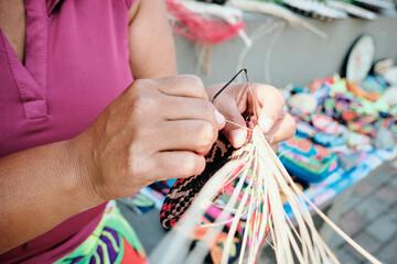 Indigenous Woman Weaving Coaster At Street Market Stall