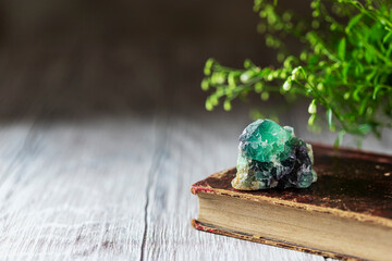 Old book and mineral stones crystals. Crystal Ritual, Healing Crystals. Natural gemstones. Gemstones are full of healing energy and good vibes.