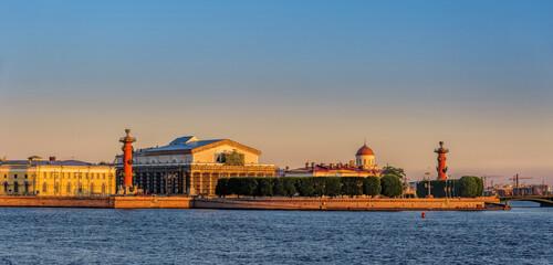 Sunrise panorama of Neva river, bridges and the Spit of Vasilyevsky island after summer white night. Saint-Petersburg, Russia.