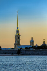 Sunrise view of Petropavlovskaya (Peter and Paul) fortress and orthodox Peter and Paul Cathedral on Zayachy Island after summer white night. Saint-Petersburg, Russia