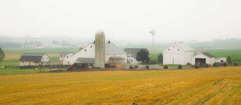 Amish farm with barn and agriculture fields in foreground near Intercourse, Pennsylvania.