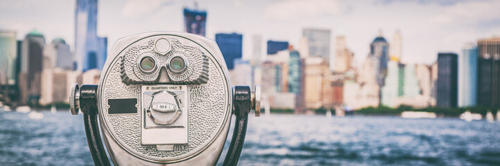 New York City travel tourist attraction icon - coin binocular tower viewer on skyline background in summer. USA destination panoramic banner.