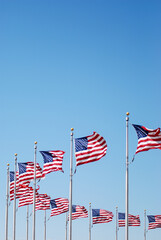 Obraz Low Angle View Of National Flags Against Clear Blue Sky - fototapety do salonu