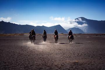 Horsemen riding in Desert