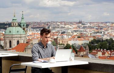 Joseph Petrila uses a laptop in Prague