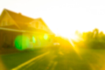 Blurred abstract background of Luxury house at the sunset. House exterior theme creative abstract blur background with bokeh effect. Blurred house and lawn