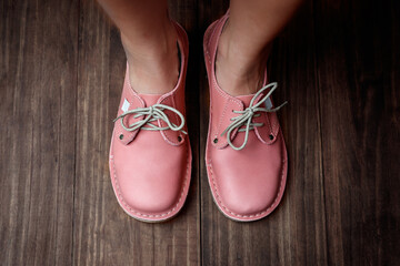 Pink ladies leather shoes isolated close-up Wall mural