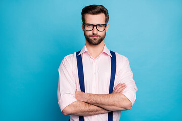 Photo of handsome macho business man cool trend clothes guy smile without teeth eyesight vision specs arms crossed wear pink shirt suspenders pants isolated pastel blue color background