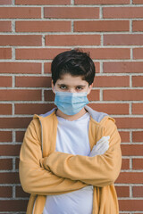 sad kid wearing medical mask