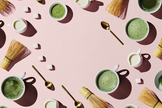 Flat lay of tools for making and cups of vegan matcha latte with oat milk