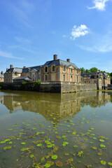 La Ferte Saint Aubin, France, 05-28-2017 castle ensemble bridge and pond with water lilies