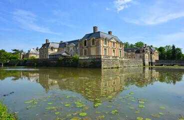 La Ferte Saint Aubin, France, 05-28-2017 historical castle ensemble with pond and water lilies