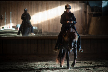 Woman Riding Horse Indoors