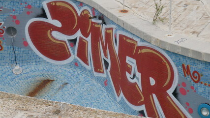 Abandoned swimming pool with graffitties