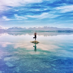 Full Length Of Woman Standing On One Leg Over Rock In Lake Against Sky