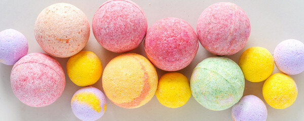 Obraz Multicolored bath bombs on a gray background top view, banner - fototapety do salonu