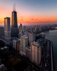 Aerial View Of Buildings And River In City During Sunset - fototapety na wymiar