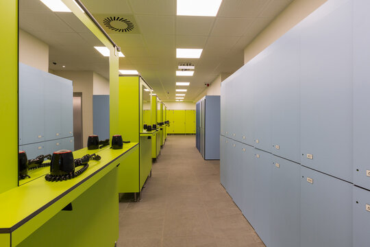 Interior of a indoor swimming pool changing and locker room with hair dryers