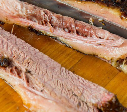 Beef Brisket barbecue Traditional Texas Smoke House . Rubbed with spiced & slow smoked in a classic Texas smoke house over mesquite wood chips in traditional classic bbq method. Chopped Beef Brisket.