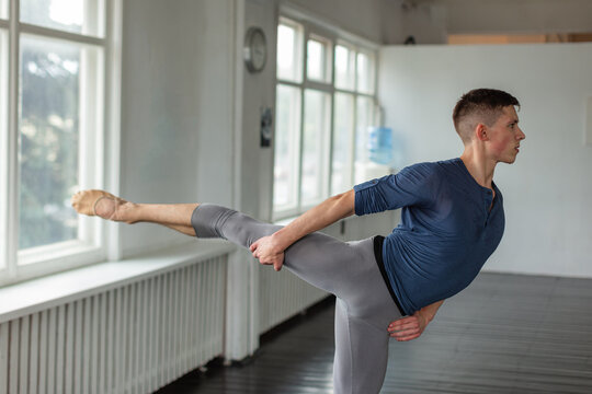 Young man training ballet at school.